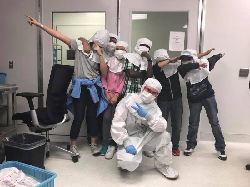 kids dressed up in cleanroom suits